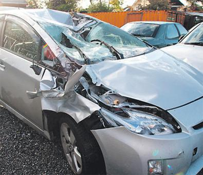 A priest had a narrow escape, above, after a tree fell on his car yesterday