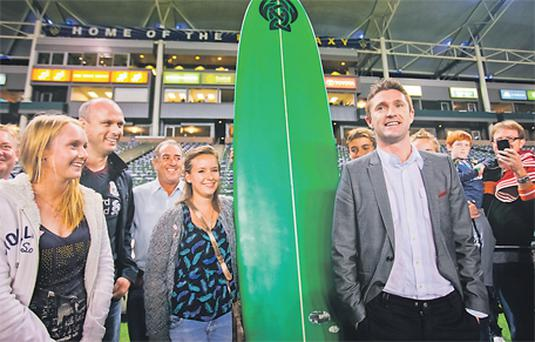 Robbie Keane is presented with a custom-made surfboard as a welcome gift by the local Irish community after the LA Galaxy v Chivas USA game at The Home Depot Centre in LA