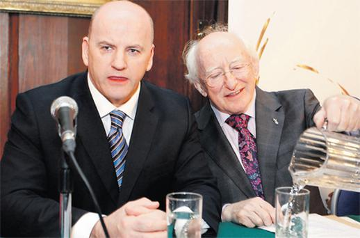 Presidential candidates Sean Gallagher, left, and Michael D Higgins during yesterday's Inclusion Ireland Debate at the Mansion House in Dublin