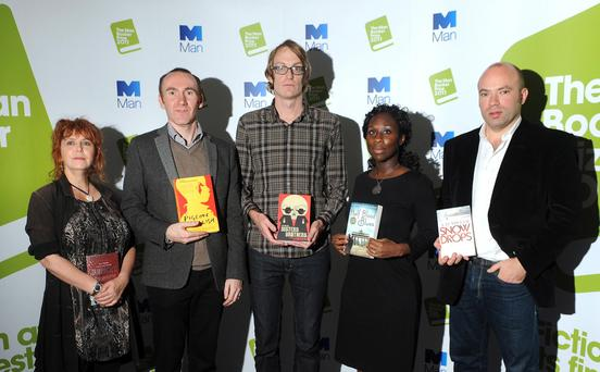 File photo dated 17/10/11 of the shortlisted authors for the Man Booker prize, (left to right) Carol Birch, Jamrach's Menagerie; Stephen Kelman, Pigeon English; Patrick DeWitt, The Sisters Brothers; Esi Edugyan, Half Blood Blues and AD Miller, Snowdrops; pose during a photo call at the Institute of Engineering and Technology (IET) Savoy Place, London. PRESS ASSOCIATION Photo. Issue date: Tuesday October 18, 2011. See PA story ARTS Booker. Photo credit should read: Anthony Devlin/PA Wire