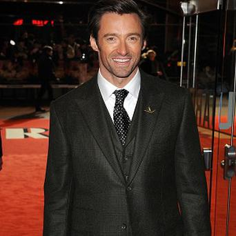 Hugh Jackman's Real Steel robots are battling it out with the dancers of Footloose for box office supremacy