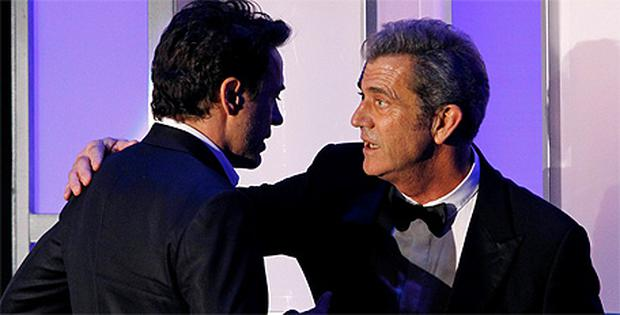 Robert Downey Jr is embraced by presenter Mel Gibson after accepting the 25th American Cinematheque Award in Beverly Hills
