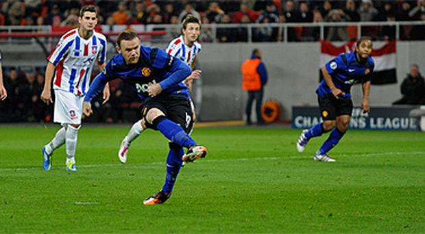 Wayne Rooney scores from the spot
