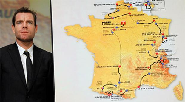 Cadel Evans of Australia poses next to the newly-released itinerary of the 2012 Tour de France
