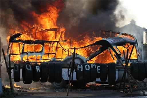 A caravan burns at Dale Farm in Essex where supporters have clashed with bailiffs and riot police. Photo: PA