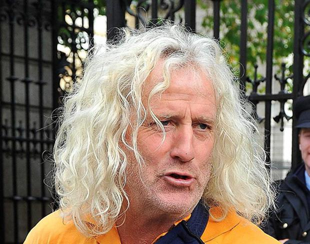 Mick Wallace, T.D., with his arm in a sling outside the Dail today. Picture credit; Damien Eagers 12/10/2010