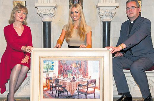 Rosanna Davison and her mother Diane join the Dean of Christ Church Cathedral, the Very Reverend Dermot Dunne, to launch a major fundraising auction for the cathedral's upkeep