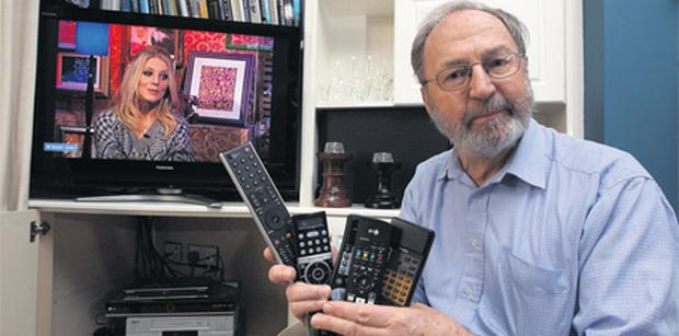 Get connected: Paddy Mulhern from Kinsale, Co Cork, with his many remote controls
