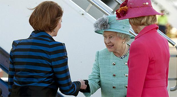 Australian Prime Minister Julia Gillard greets Queen Elizabeth with a handshake. Photo: PA