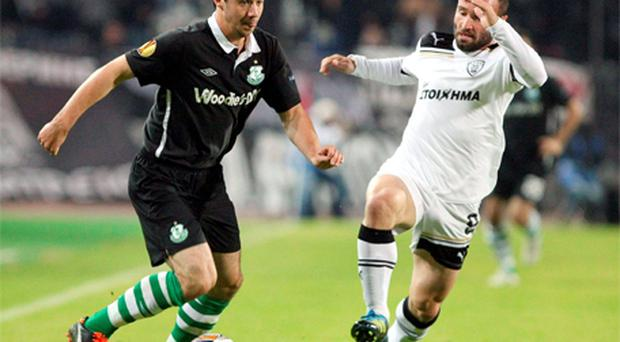Enda Stevens of Shamrock Rovers is challenged by PAOK Salonika's Bruno Cirillo during the Europa League game in Thessaloniki last night - Rovers