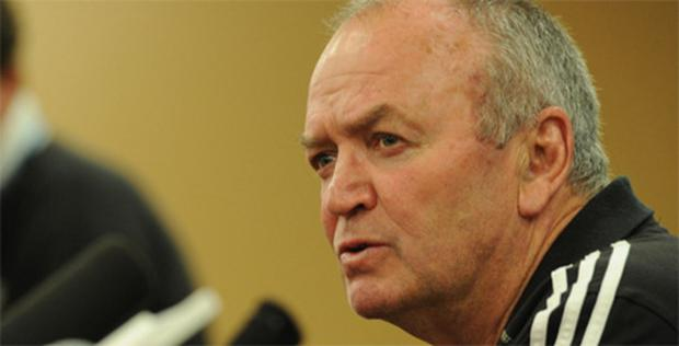 Graham Henry answers a question during a press conference in Auckland
