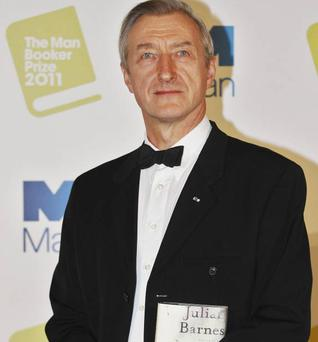 British author Julian Barnes poses with his book