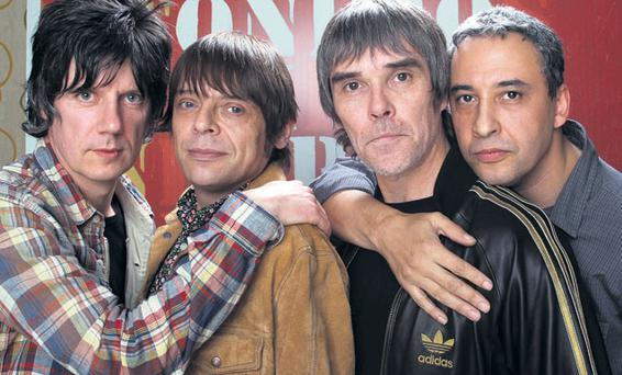 Banging the drum again: Stone Roses John Squire, Mani, Ian Brown and Reni at this week's reunion announcement
