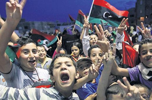 children celebrate in Tripoli