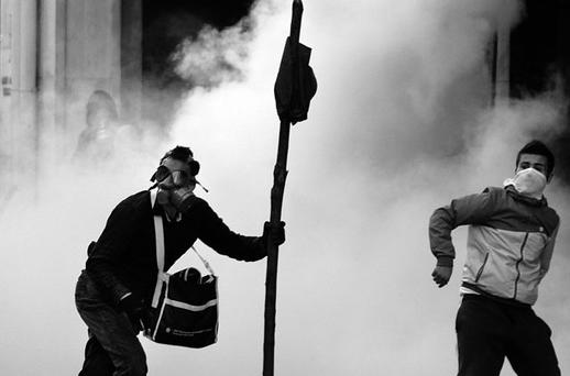 GREEK TRAGEDY: Anti-austerity protesters clash with police in Syntagma Square, Athens, on October 20. Despite Greece's failure to meet its economic targets, it is still being propped up by the Troika