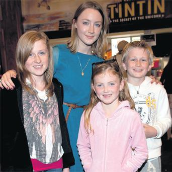 Saoirse Ronan with Ali McCool (13), Emelia Devlin (8) and Evan McCool (11) at the Irish premiere of 'Tin Tin' at the Savoy Cinema, Dublin, last night