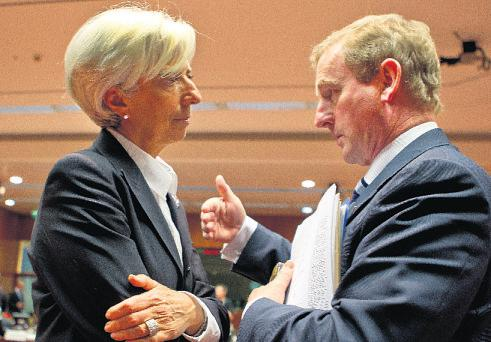 Managing director of the IMF, Christine Lagarde, with Taoiseach Enda Kenny in Brussels yesterday