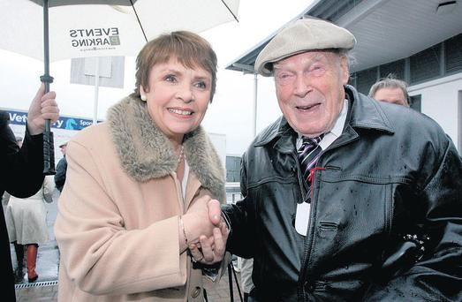 Dana Rosemary Scallon meets 91-year-old Roy Spiller, from Kilkenny, during her visit to the races at Ballybrit in Galway yesterday