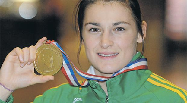 Katie Taylor, the golden girl of Irish boxing – complete with her latest Euro gold medal in hand – arrived home to a hero's welcome at Dublin Airport last night, where she was mobbed by family, friends and supporters