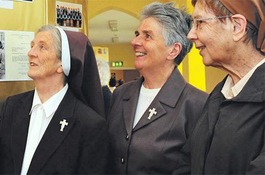 Poor Clare nuns, Sr Assumpta Hegarty, Sr Concepta Looney and Sr Catherine Brosnan take a nostalgic stroll around their old convent and peruse old photographs as they celebrated the order's 150th anniversary in the town