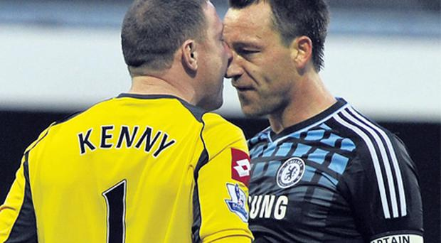 Queen's Park Rangers' goalkeeper Paddy Kenny and Chelsea's John Terry confront each other at Loftus Road yesterday