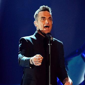 Robbie Williams has signed to a new label