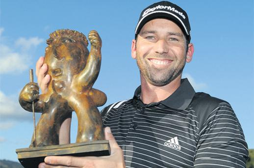 Sergio Garcia holds the trophy after winning the Castello Masters at the Club de Campo del Mediterraneo yesterday