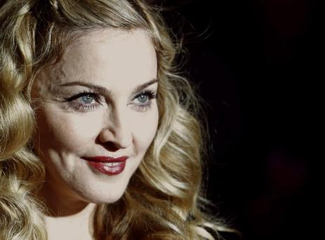 Director Madonna arrives for the gala screening of her film W.E. during the BFI London Film Festival at Leicester Square in London October 23, 2011. REUTERS/Luke MacGregor (BRITAIN - Tags: ENTERTAINMENT HEADSHOT)