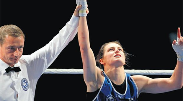 Katie Taylor looks to the heavens after being confirmed European champion