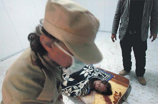 Muammar Gaddafi's beaten and bloody corpse was kept in a meat locker over the weekend so the public could see it