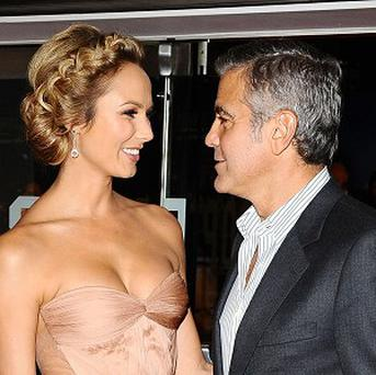 George Clooney and Stacy Keibler arrive at the premiere of The Descendants
