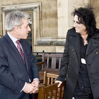 Rocker Alice Cooper with Speaker John Bercow outside the Houses of Parliament