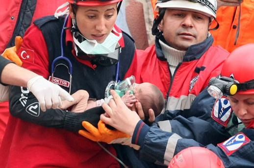 Rescue workers carry Azra Karaduman, a two-week-old baby who was pulled from the debris of the earthquake. Photo: Getty Images