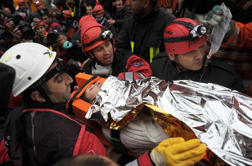 Relief workers completed a rescue hat trick on Tuesday, plucking first a baby, then her mother and finally her grandmother from the rubble of Turkey's earthquake that killed at least 370 people. Photo: Getty Images