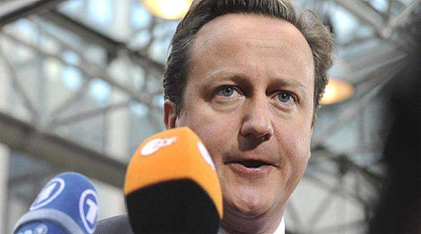 British Prime Minister David Cameron addresses the media in Brussels