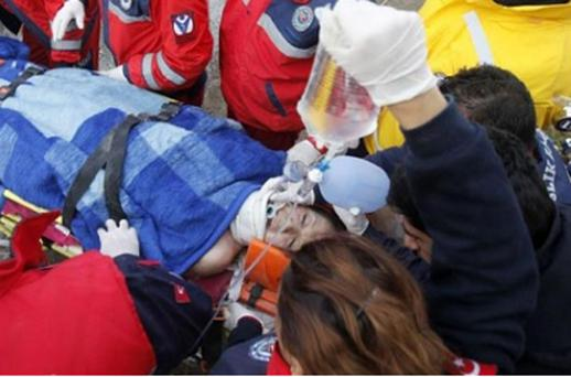 Earthquake survivor Gozde Bahar is carried to an ambulance by rescue workers in Ercis. Photo: Reuters