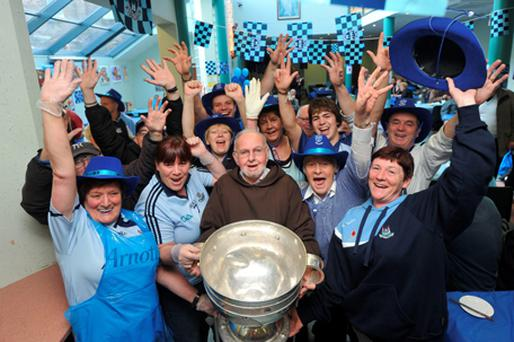 Brother Kevin Crowley of the Capichin Day Centre lifts the Sam Maguire cup. Photo: Damien Eagers