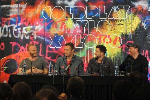 Handout photo issued by EMI of the band Coldplay, (from left to right) Will Champion, Chris Martin, Guy Berryman and Jonny Buckland during a press conference to launch their new album entitled Mylo Xyloto. PRESS ASSOCIATION Photo. Picture date: Wednesday October 26, 2011. See PA story SHOWBIZ Coldplay. Photo credit should read: EMI/PA WireNOTE TO EDITORS: This handout photo may only be used for editorial reporting purposes for the contemporaneous illustration of events, things or the people in the image or facts mentioned in the caption. Reuse of the picture may require further permission from the copyright holder.