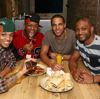 JLS are standing by their former X Factor mentor Louis Walsh