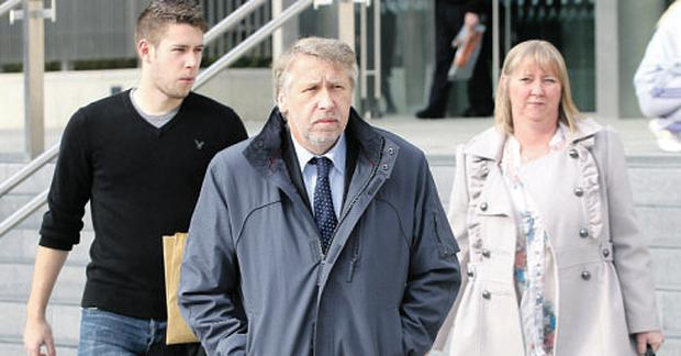 Alleged victims Paul Richardson, centre, and his wife Marie, leaving court yesterday with son Ian