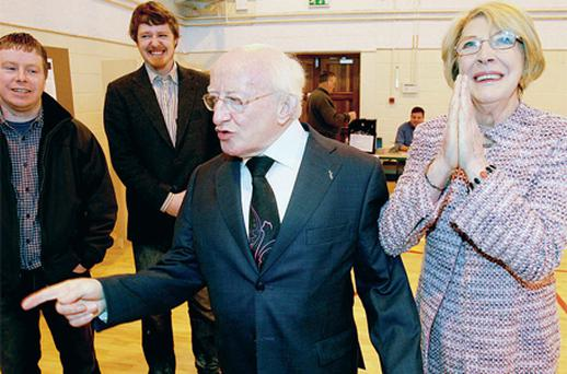 Michael D Higgins and his wife Sabina and sons Michael Jnr and Daniel in Galway