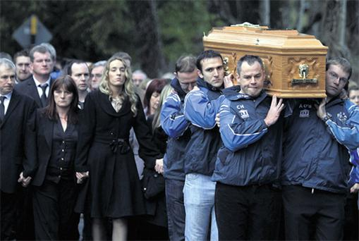 Mourners including his parents follow the coffin of Gda Ciaran Jones at Manor Kilbride