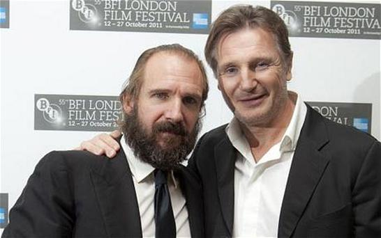 Liam Neeson presented Ralph Fiennes with his award. Photo: PA