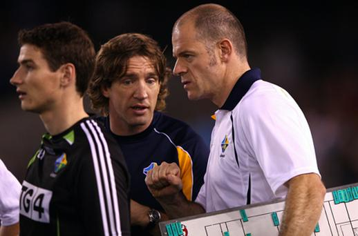 Ireland manager Anthony Tohill speaks with assistant Kieran McGeeney during today's game. Photo: Getty Images
