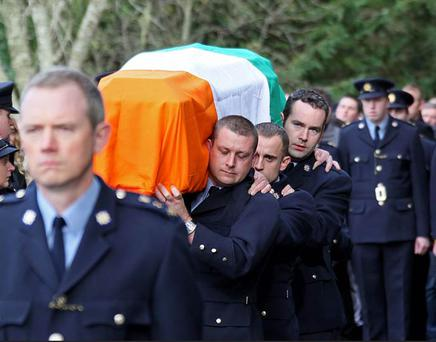 The funeral of Garda Ciaran Jones who died during the floods earlier this week. The funeral took place at St. Bridgets Church, Manor Kilbride, Co. Wicklow yesterday afternoon. Photo: Colin Keegan, Collins
