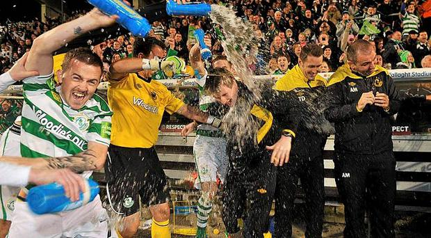 Shamrock Rovers players Gary McCabe, left, and Richard Brush celebrate at the end of the game after being presented with Airtricity League Premier Division trophy. Photo: David Maher / SPORTSFILE
