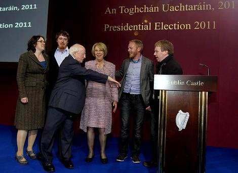 Newly elected President of Ireland Michael D.Higgins and his wife Sabina celebrate at Dublin Castle Count Centre last night with his family (from left), Alice Mary, Michael, Daniel and John Photo:Mark Condren