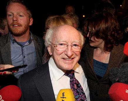 Michael D Higgins surrounded by friends, family and media at last night's count. Photo: Arthur Carron / Collins