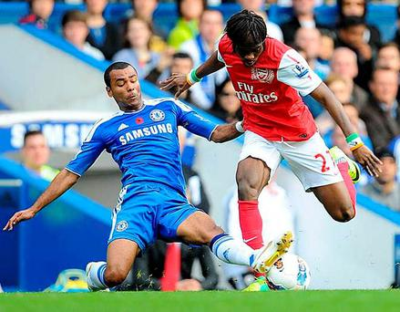 Chelsea's Ashley Cole tackles Arsenal's Gervinho. Photo: Dominic Lipinski/PA Wire