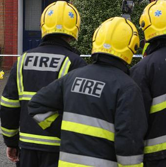 Firefighters had to rescue a suspected burglar from a rooftop